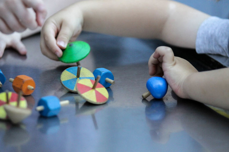 High angle view of babys playing with toys on table