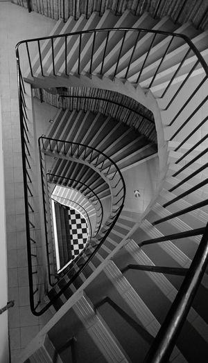 More than mere arts. Spiral Staircase Hand Rail Spiral Stairs Stairs Steps And Staircases Spiral Steps Staircase Railing Design Semi-circle Geometric Shape Repetition Pattern Architectural Detail EyeEmNewHere
