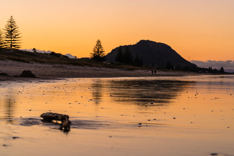 Sunset at Bay of Plenty, NZ Bay Of Plenty Region Sunset Silhouettes Sunset_collection Tauranga Beach Beauty In Nature Clear Sky Idyllic Lake Land Mountain Nature New Zealand No People Non-urban Scene Orange Color Reflection Scenics - Nature Sky Sunset Tranquil Scene Tranquility Water