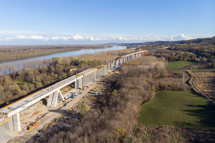 High angle view of bridge over landscape against sky