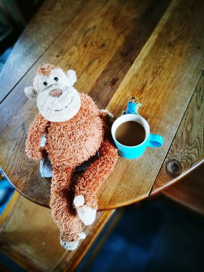 Indoors  Coffee Cup Toy Stuffed Toy High Angle View Drink Teddy Bear Coffee - Drink Food And Drink Table No People Day Close-up Oak Table Blue Coffee Cup Blue Mug Soft Toy Snail Blue Coffee Mug Kitchen Life Kitchen Art Kitchenware Kitchen Table Oak Kitchen Table