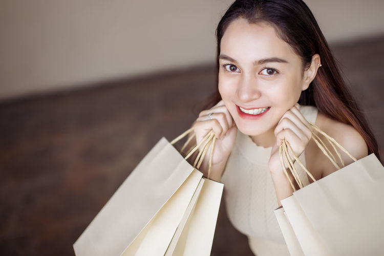 young women happy with many shopping bag Beautiful Copy Space Happiness Joyful Market Relaxing Sale Shopping Bag Cheerful Discount Happiness Holding Lifestyles Looking At Camera Mall Paper Portrait Relax Shop Smiling Store Women Young Adult Young Women