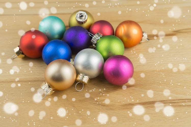 Close-up of christmas ornaments on table