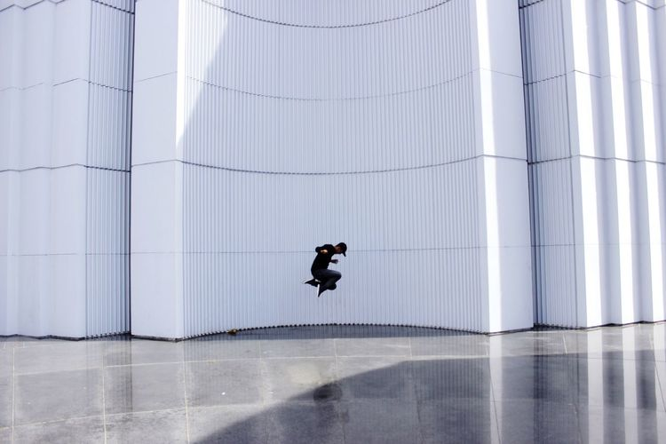 Man jumping in modern building