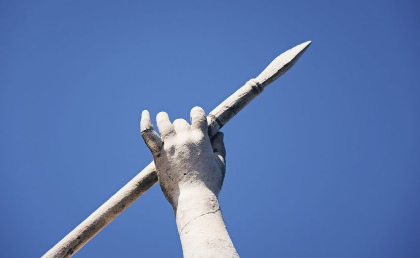 Sculpture Of Human Hand Holding Spear