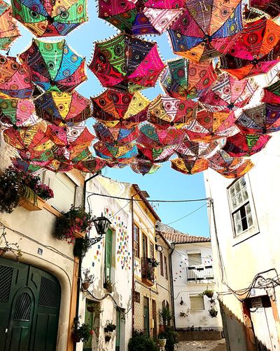 """Travessa de """"Barril"""" Street Streetphotography Colors Umbrellasky Umbrellastreet Umbrellas In The Sky Umbrella Architecture Building Exterior Built Structure Day Residential Building Outdoors Low Angle View Hanging No People Multi Colored Clear Sky City Sky"""