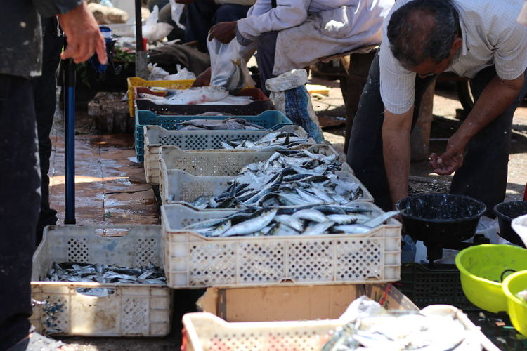 Market Food Market Food And Drink Group Of People Market Stall Retail  Incidental People For Sale Retail Display Outdoors Preparing Food Selling Wellbeing Group Sale Business Small Business Freshness Day Occupation Choice Real People Maroc Agadir Morocco