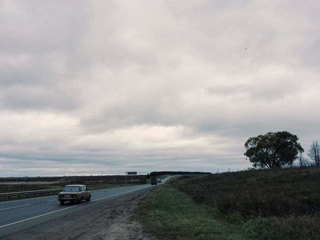 The Drive Sky Road Cloud - Sky Car Transportation Nature Mode Of Transport Landscape Outdoors No People Land Vehicle Day Highway Rear View Rural Scene The Way Forward Retro Overcast Cinematic