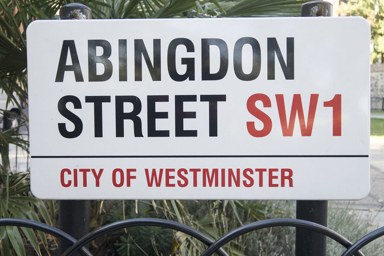 London, United Kingdom - 11 October 2018; Abington street, street sign in London, a street close the the houses of Parliament and the college green a public garden Street Sign Abingdon Street Abingdon London United Kingdom Westminster No People Day Sign Communication Text Red Capital Letter