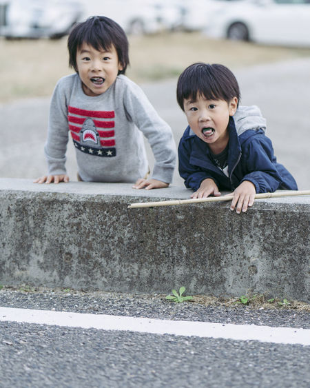 Childhood Child Boys Men Two People Males  Togetherness Real People Portrait Leisure Activity Casual Clothing Family Lifestyles Brother Day Looking At Camera Emotion Bonding Innocence Positive Emotion Sister Outdoors