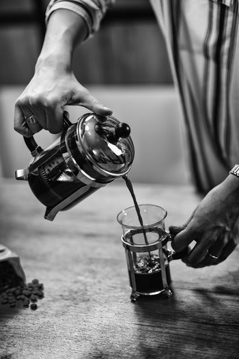 French Press Coffee Coffee French Press Female Woman Cafe Home Drink Cup Glass One Person person Enjoy People Caucasian Lifestyle Caffeine Indoors  Holding Aroma Black And White Break Drinking Coffee Cup Pouring Food And Drink Table Indoors  Hand Human Hand