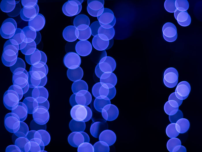 Blurred lights on night time. Background and circle bokeh for christmas and New year festival. Abstract Back Black Bokeh Christmas Circle Colorful Effect Festival Gleam Ivy Light New Year Night Wall Xmas