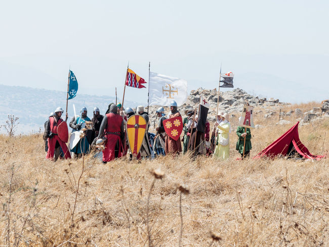 Tiberias, Israel, July 01, 2017 : Participants in the reconstruction of Horns of Hattin battle in 1187 Dressed in the costumes of crusaders stand in anticipation of an attack near Tiberias, Israel Battle Cross Crusaders Field Fire Guy De Lusignan Hattin Heat Heritage History Horn Horseman Infantry Israel Jerusalem KINGDOM Knight  Muslims Palestine Religion Saladin Templars Victory War Weapons