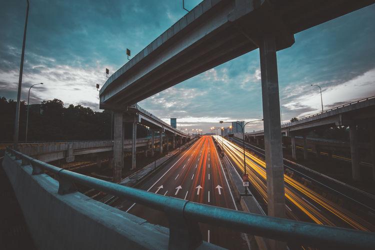 Long exposure of cars on bridge at dusk
