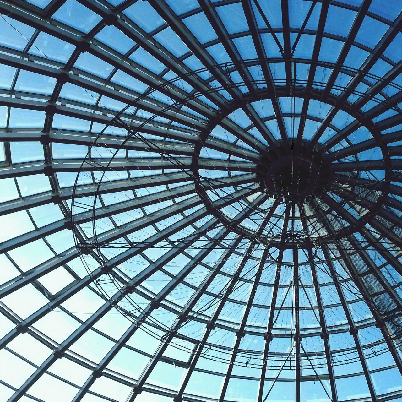 low angle view, indoors, architecture, built structure, modern, pattern, full frame, no people, day, dome, sky, city