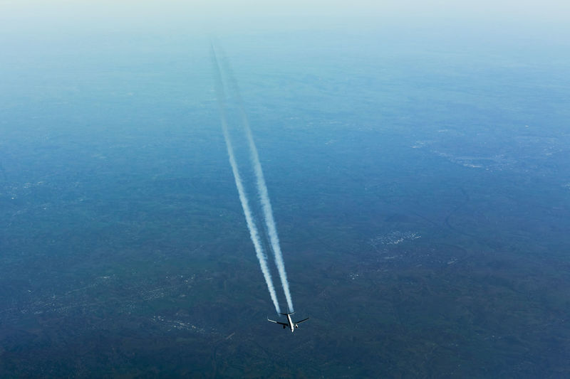 Aerial view of vapor trail over landscape