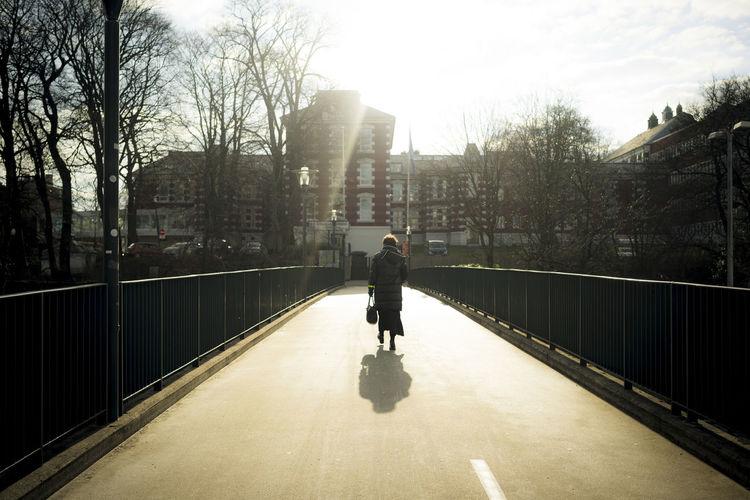 Commuting Light Stavanger Woman Backlit Bridge Shadow Streetphotography Sun