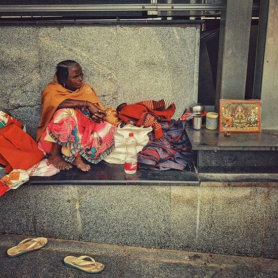 AIIMS Metro 19 Aiimsmetro An Indian woman in a pensive mood at the AIIMS metro station in Delhi, India. AIIMS metro station, New Delhi, serves as a temporary shelter for the family members of the countless patients undergoing treatment at the All India Institute of Medical Sciences (AIIMS). These people cannot afford to stay at lodges or hotels till their loved ones are treated, thus choosing to dwell at or in the vicinity of the AIIMS metro station. Also, the national capital has thousands who are homeless. Metro stations are one of the commonest spots where the deprived take refuge. Blankets, utensils, kitchen accessories, old cartons, tarpaulin sheets and other household paraphernalia are a common sight at these makeshift shelters. Everydayeverywhere Everydayindia Dailylife Photojournalism Journalism Reportage Reportagespotlight Indiaphotoproject Dfordelhi Sodelhi DelhiGram Onepluslife Delhi Newdelhi ASIA India