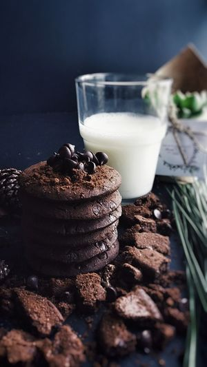 Cookies and glass of milk on table