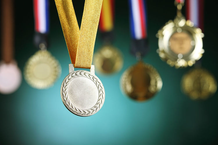 Close-up of medals against blackboard