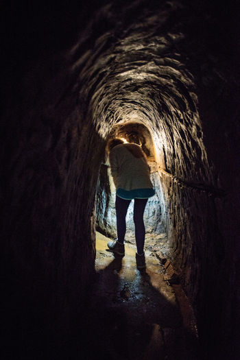 Vietnam 2018 VietCong Arch Architecture Bombs Bombshell Casual Clothing Dark Day Direction Full Length Indoors  Leisure Activity Lifestyles Light At The End Of The Tunnel Men Outdoors People Real People Rear View Standing The Way Forward Tunel Tunnel Vietnamwar War Women