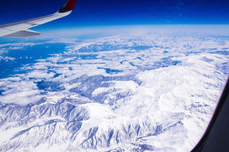 Fly Flying Flying High Airplane Illuminator Snow Beauty In Nature Winter Cold Temperature Scenics Sea Sea And Sky Seascape Blue Sky Tranquil Scene Airplane Wing Wing Space Rocks Mountains Rockmountain Tranquility No People Landscape