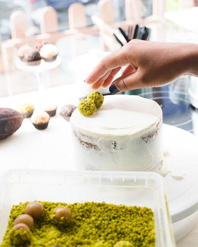 Cropped Hand Garnishing Cake