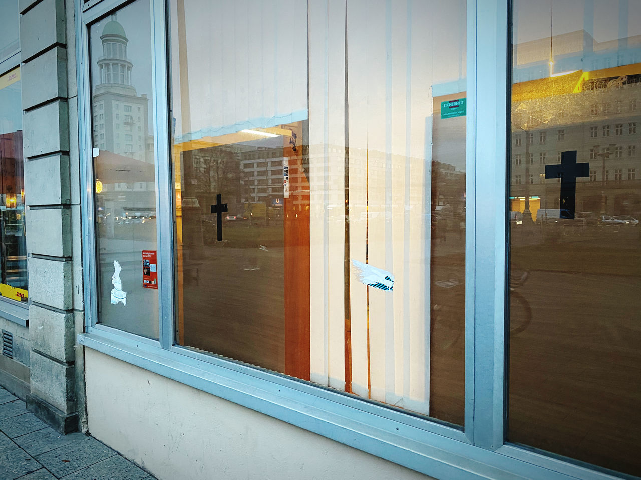 architecture, door, entrance, built structure, glass - material, transparent, no people, building exterior, building, reflection, closed, outdoors, security, day, window, protection, city, safety, communication, glass