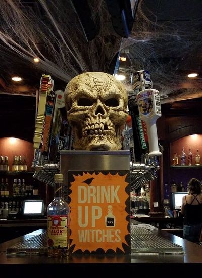 October on Tap. Text Night Illuminated Indoors  No People Arts Culture And Entertainment Beer Close-up Tap House Skull Face Bar - Drink Establishment Halloween Tappers