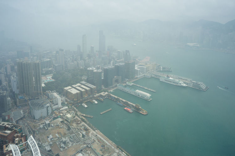 Victoria Harbor or Hong Kong ASIA Hong Kong Hong Kong City Hong Kong Harbour Hong Kong Skyline Hong Kong Architecture HongKong Skyline Aerial View Architecture Building Built Structure China City Cityscape Day Fog Harbor Nautical Vessel Outdoors Sea Shipping  Skyscraper Transportation Water