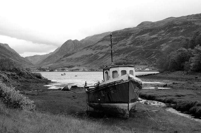 Old Ship Scotland Wreck Beauty In Nature Day Dreamy Environment Field Lake Land Land Vehicle Landscape Mode Of Transportation Moony Mountain Mountain Range Nature No People Non-urban Scene Outdoors Scenics Scenics - Nature Ship Sky Transportation