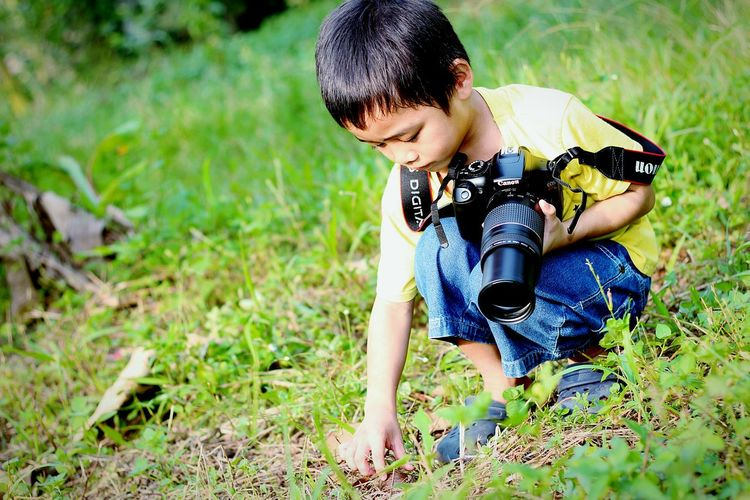 EyeEm Selects Grass Child People Outdoors One Person Day Childhood Adult Fun Sitting Playing Girls Nature Happiness Children Only Adventure Real People Portrait Human Body Part One Boy Only MySON♥ Ezzra Canonphotography
