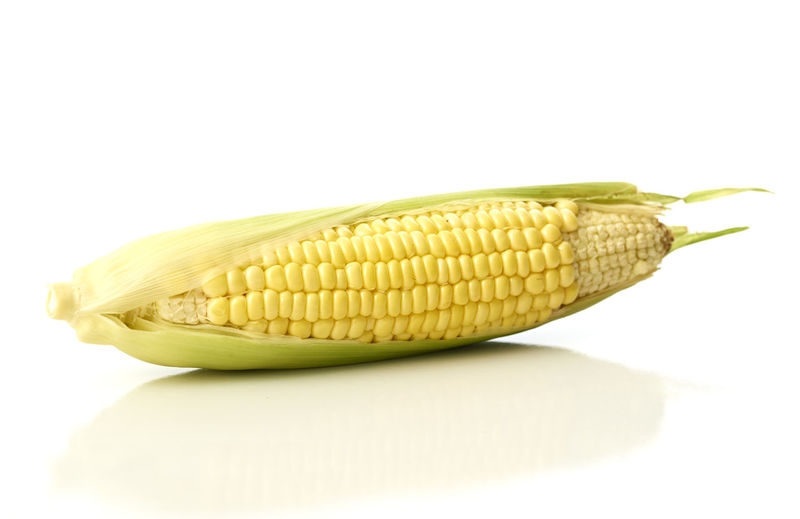 Close-Up Of Corn Over White Background