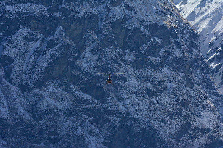 High angle view of helicopter against snowcapped mountain, anapurna