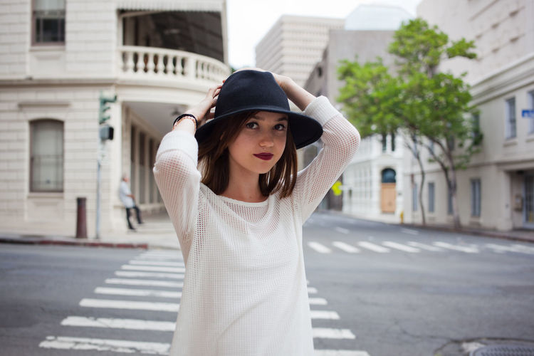 Young woman with hat on road