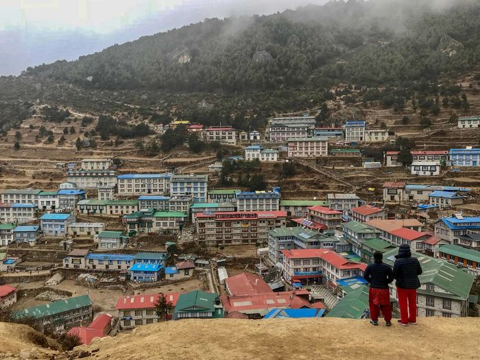 Everest Base Camp Trek Nepal - view of Namche Bazaar Building Exterior Built Structure City Group Of People High Angle View Mountain Residential District Standing Women