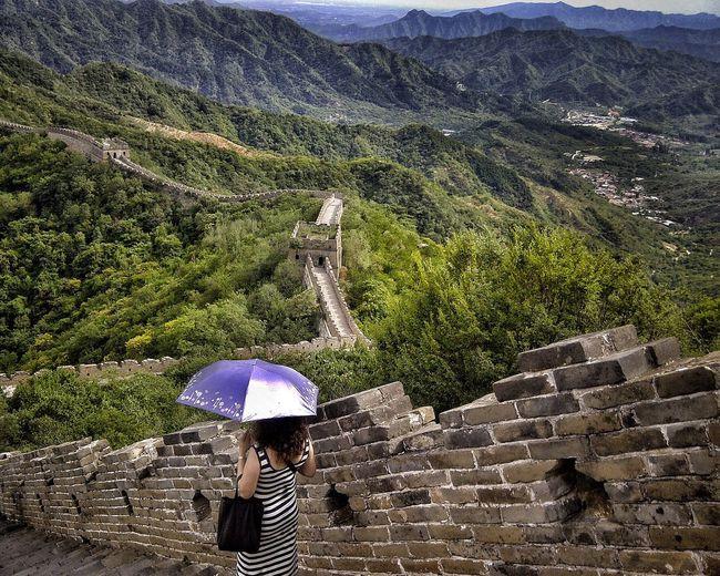 High Angle View Of Woman Carrying Umbrella At Great Wall Of China