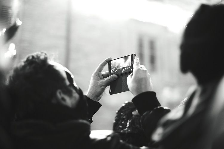 Rear view of woman photographing