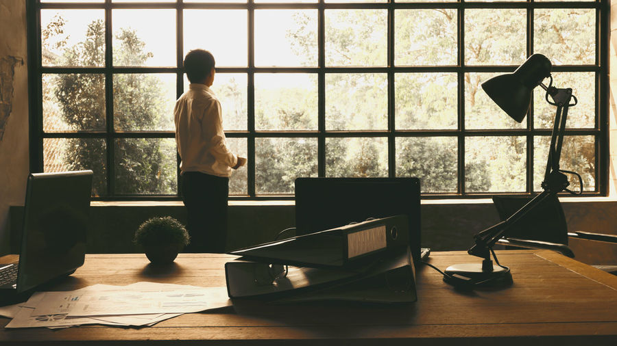 Business executives stood looking out the window to find inspiration. Or the idea to make his business the most successful Window Indoors  One Person Real People Standing Transparent Lifestyles Office Men Successful Business Idea 🙄 Inspiration Executives Glass - Material Rear View Full Length Day Domestic Room