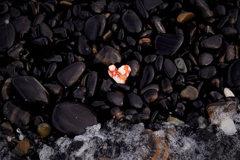 Full frame shot of pebbles on rocks
