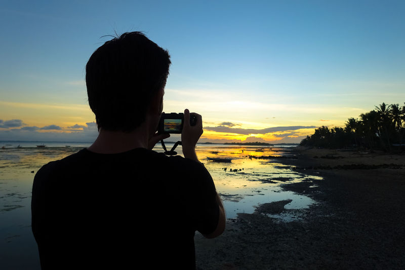 Photographer man silhouette taking pictures on sunset beach Beach Landscape Beach Photographer Beach Sunset Bohol Bohol Philippines Digital Nomad Dusk Colours Dusk Sky It's More Fun In The Philippines Life Goals Living The Dream Love Life Man Silhouette Philippines Photos Photographer Silhouette Sea Landscape Snapping Pics Solo Solo Travel Solo Traveler Solo Traveller Taking A Picture Taking Pics Tide Pools Vagabond