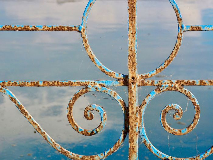 EyeEm Selects No People Full Frame Pattern Backgrounds Day Design Close-up Metal Shape Blue Outdoors Geometric Shape Art And Craft Creativity Circle Rusty Weathered