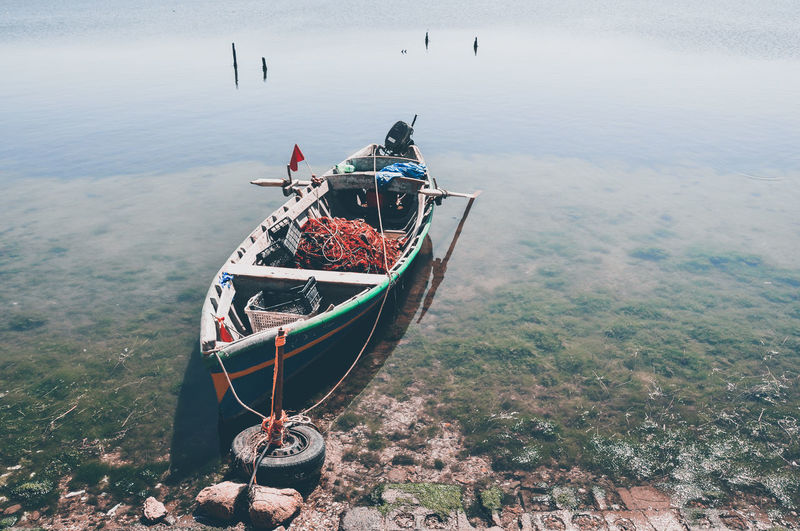 High angle view of fishing boat on sea shore