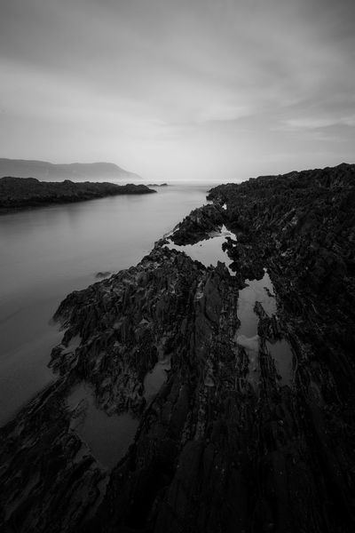Rocky tide pools at Nature's Valley Beach, Eastern Cape, South Africa Beauty In Nature Contrast Day Monochrome Mountain Nature No People Outdoors Rock - Object Rocky Pool Scenics Sea Sky Tidal Pool Tranquil Scene Tranquility Water