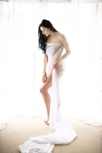 One Person Young Adult Indoors  Standing Hair Hairstyle Lifestyles Real People Women Side View Long Hair Full Length White Color Young Women Black Hair Day Wall - Building Feature Leisure Activity Beautiful Woman