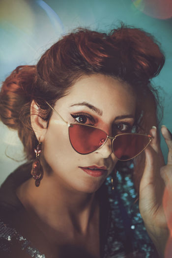 Portrait Fashion Young Adult Headshot Sunglasses Glasses One Person Looking At Camera Lifestyles Real People Young Women Women Leisure Activity Front View Adult Beauty Beautiful Woman Close-up Hairstyle #Glamour #earrings #peacocks #background #lamps #india #indianculture #market #delhi #red #hairstyle #RedHead  #makeup #headshot