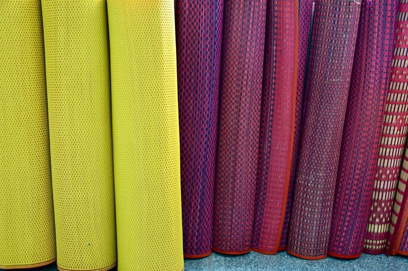 Close-up of yoga mats for sale in market