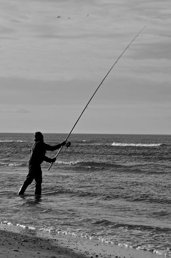 Beauty In Nature Day Fishing Fishing Rod Full Length Holland Horizon Over Water Iland Leisure Activity Lifestyles Nature Outdoors Scenics Sea Shore Sky Vacations Water