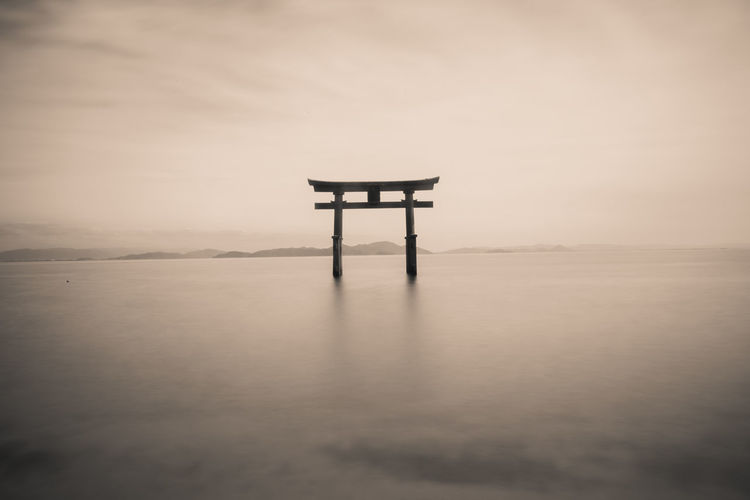 Shirahige Shrine Torii Gate In Biwa Lake Against Sky