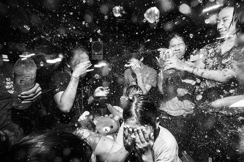 Freak Songkran / Songkran is an annual festival in Thailand celebrating the traditional Thai New Year. Water is splashed and poured onto people as a symbol of washing away all of their sins and bad luck. Sometimes, it gets a little freaky. Kids Water Bangkok Thailand. Check This Out Dark Blackandwhite Showcase July Black And White Black & White Streetphoto_bw Streetphotography Streetphoto Photooftheday Streetphotographer Street Photography Thailand EyeEm Best Shots EyeEm Best Shots - Black + White Bangkok